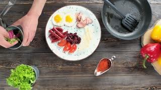 English breakfast preparation. Tasty food on wooden background.