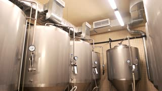 Equipment for beer production, private brewery. Contemporary large steel barrels in winery.