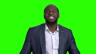 Excited businessman celebrating victory. Slow motion happy cheerful male corporate clenched fists on chroma key background. Career achievement concept.