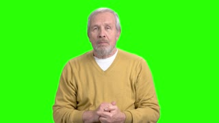 Excited elderly man on green screen. Happy shocked elderly man clenched his fists, chroma key background. Expression of victory.