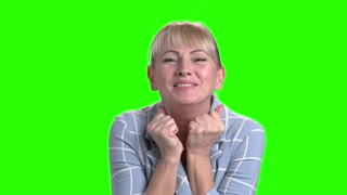 Excited mature woman on green screen. Portrait of beautiful joyful woman on Alpha Cannel background. Human positive expressions.