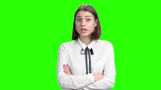 Extremely angry female manager scolding you. Green screen hromakey background for keying.