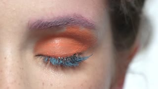 Eye makeup macro. Bright orange eyeshadow.