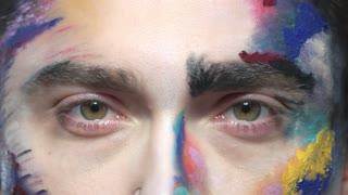 Eyes of man, artistic makeup. Male eyes macro.