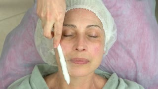 Face cryomassage, mature woman. Cosmetician using liquid nitrogen. New methods of skin therapy.