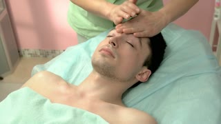 Face massage, handsome man. Hands of masseuse. Massage tips from professionals.