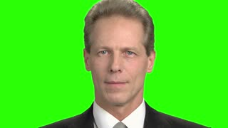 Facial emotions, cheers and suspect. Close up mature man smiling with teeth, green screen hromakey background.