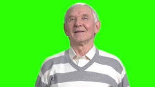 Facial expressions of old grandpa. Front view smiling old grandfather, green hroma background.