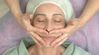 Facial gel mask, adult woman. Hands of cosmetician, top view.