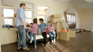 Family and cardboard boxes. Man and woman, high five. Tips for a successful move.
