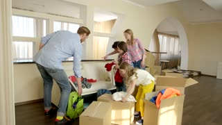 Family moving out. People packing boxes indoors. Importance of helping each other.