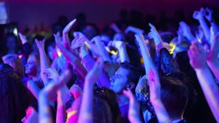 Fans waving their hands at a concert. Youth party.