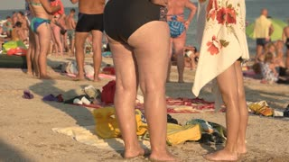 Fat woman and slim girl. Female legs on beach background. Fitness versus obesity.