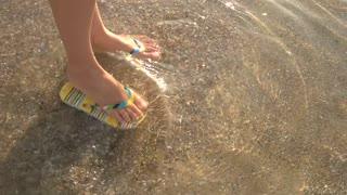 cda046498c2f5 Woman putting her flip flops on her feet on the sand beach Stock Video  Footage - Storyblocks Video