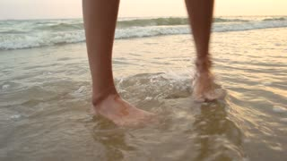 Feet of young woman, seashore. Legs walking on wet sand. Set yourself free.