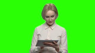 Female business speaker with tablet. Portrait of business coach. Green screen hromakey background for keying.