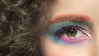 Female eye and hair, makeup. Pink and blue eyeshadow. Marketing ideas for cosmetics company.