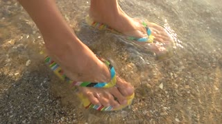 6f10f7cc45c8f Children s feet in flip flops in a spray of water from a fountain Stock  Video Footage - Storyblocks Video