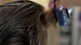 Female hair and blow dryer. Work of hairdresser close up.