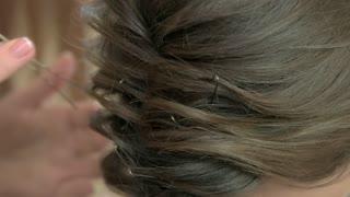 Female hairdo close up. Hair with bobby pins.