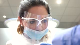 Female stomatologist in mask. Woman doctor working. How to become a dentist.