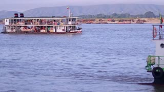 Ferry floating with people on the river. Burmese old excursion ferry.