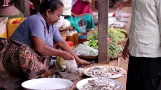 Fish market in Myanmar. Local merchants sell the fish. Food market. Unsanitary conditions on the market. Dirty food market.