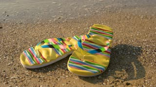Flip flops on sand background. Footwear on shore. Summer at the tropical island.