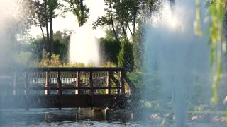 Fountains and small bridge. Water in slow motion. Beautiful parks of the world.