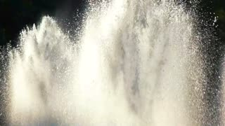 Fountains and sunlight, slow-mo. Splashes of clean water.