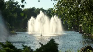 Fountains, nature and house. Trees near the water. Real estate rent in suburbia.