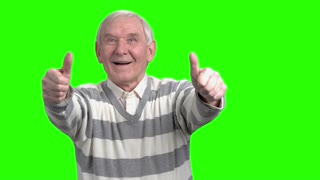 Front view of two thumps up from old man. Merry grandpa with thumbs up in green hromakey background.