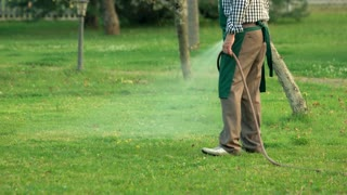 Gardener holding water hose. Tool spraying water. Buy quality gardening equipment.