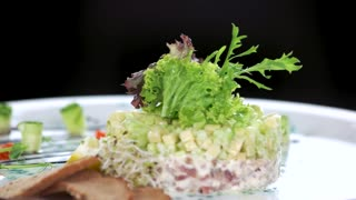 Garnished herring tartare. Tasty food macro.