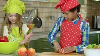 Girl and boy cooking. Kid cutting tomato. Things every cook should know.