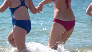 Girls swim in the sea. Summer holiday. Long-awaited vacation. Bathing on a hot day. Summer holiday. Long-awaited vacation. Bathing on a hot day.