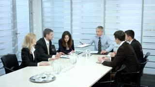 Glass office interior. Business meeting. Businessmen discussing a contract.