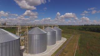 Grain bins, horizon and sky. Wheat field.