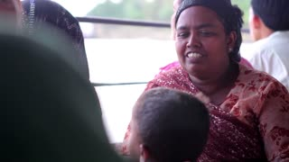 Grandmother and grandson on the ferry. Refugees on the ferry. Migrants goes in search of a better life.