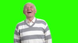 Grantpa laughing at your joke. Laughing candid old senior man.