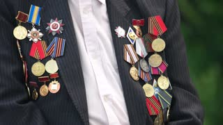 Great world war veteran with medals. Close up. Jacket with awards.