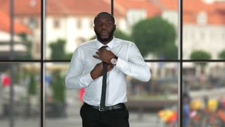 Guy fixing tie. Formally dressed black man. Business fashion tips.