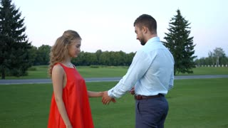 Guy puts on a ring his girlfriend. Guy confesses his love for his girlfriend. Guy makes a proposal to girlfriend at the park. Romantic date. Love story.