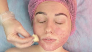 Hand applying foundation cream. Girl with eyes closed, cosmetology. Anti acne products reviews.