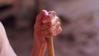 Hand of very old grandmother. Old woman with a stick. Hardworking hands.