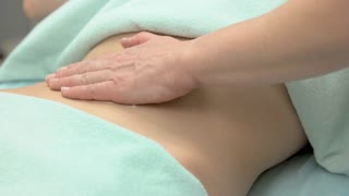 Hand of woman, belly massage. Stomach of healthy girl. Massage therapy and chemical detoxification.