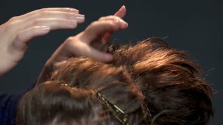 Hand using hairspray close up. Female hairstyle macro. Safe hair care products.
