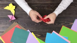 Hd 4k origami lotus videos videoblocks royalty free origami hands of man folding lotus from paper hands doing origami flower art of origami mightylinksfo