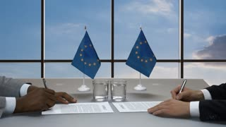 Hands of men sign papers. Businessmen shaking hands near flags. Headquarters of European Union. Make a serious step.