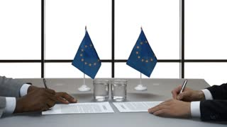 Hands of men signing papers. Handshake near EU flags. Acquire new allies. Mutual respect and common goals.